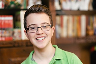 Boy with braces smiling